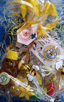 "Wonderful gift of small 2 ounce honey, 2 ounce lemongrass soap measuring 2X2 inches, tin containing lavender or coconut lotion bar, 2 honey candies, honey stick, chocolate ""honeybee"" candy, decorated edible bee candy."